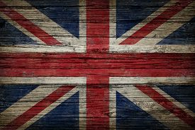 stock photo of british culture  - Great Britain flag painted on old weatheredwood as an old vintage British and United Kingdom concept of a symbol of historical patriotism and English culture on an antique textured material - JPG