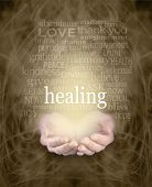 stock photo of healing hands  - Female cupped hands with the word  - JPG