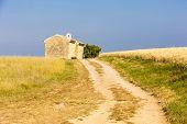 picture of plateau  - chapel with grain field near Entrevennes - JPG
