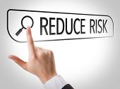 stock photo of reduce  - Reduce Risk written in search bar on virtual screen - JPG