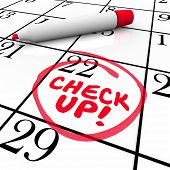 image of marker pen  - Check Up words on a calender written by red pen or marker to remind you of an exam - JPG