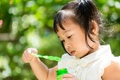 picture of blowers  - Cute girl play with bubble blower - JPG
