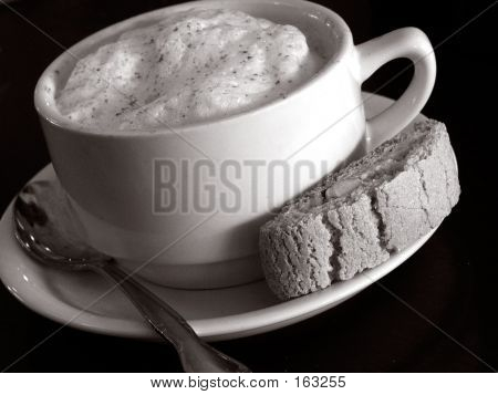 Picture or Photo of Black and white cafe latte with biscotti ** Note: Slight graininess, best at smaller sizes