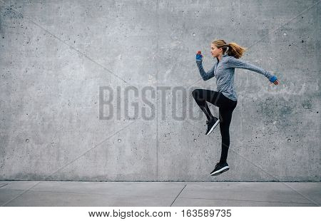 poster of Fit Young Woman Doing Cardio Interval Training