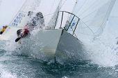 pic of sail-boats  - A sailboat tears through the rough seas of the bay - JPG