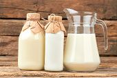 Organic Cow Milk In Glass Dishes. Vintage Style Bottles With Milk And Sour Cream. Natural Milk For H poster