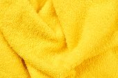 Yellow Fluffy Bath Towel Background. Vibrant Fuzzy Towel Close Up. Soft Textile Structure. poster