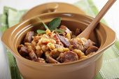Cassoulet with goose meat, pork sausage, and beans in the pot