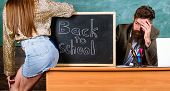 School Discipline And Behaviour Rules. Teacher Indignant Sit Table Chalkboard Background. Student Gi poster