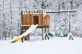 picture of swingset  - Snow falling on a backyard playset - JPG