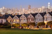 Dusk Over The Painted Ladies Of San Francisco. Iconic Victorian Houses And San Francisco Skyline In  poster