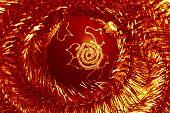 stock photo of tawdry  - red christmas ball and shiny spangle - JPG