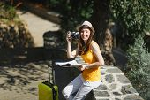 Laughing Traveler Tourist Woman In Hat With Suitcase City Map Take Picture On Retro Vintage Photo Ca poster