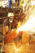 stock photo of slag  - worker using torch cutter to cut through metal - JPG