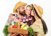 Parents And Daughter Farmers Celebrate Harvest Holiday. Family Farm Concept. Family Farmers Hug Hold poster