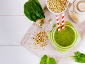 Top View Of Green Smoothie In Mason Jar On White Table. Fresh Green Smoothie With Green Buckwheat, S poster