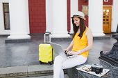 Pleasant Traveler Tourist Woman With Suitcase Sit On Stairs Using Working On Laptop Pc Computer In C poster