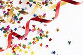 picture of reveillon  - red and golden ribbons and small confetti stars - JPG