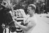 Friend, Companion, Friendship. Girl With Man Pet Horse On Sunny Day. Child With Muscular Macho Smile poster