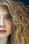 image of blonde woman  - beautiful blond woman with curly hairstyle - JPG