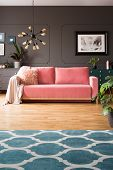 Patterned Carpet In Grey Living Room Interior With Lamp And Poster Above Pink Sofa. Real Photo poster