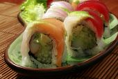stock photo of yellowfin tuna  - A plate of sushi rainbow rolls looks really yummy - JPG