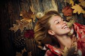 Sweet Young Woman Playing With Leaves And Looks Very Sensually. Sensual Woman Wearing Pullover, Look poster
