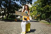 Puzzled Traveler Tourist Woman In Casual Clothes, Hat Sitting On Suitcase Holding City Map Search Ro poster