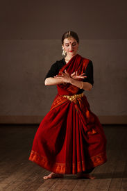 picture of bharatanatyam  - Young woman in sary dancing classical traditional indian dance Bharat Natyam - JPG