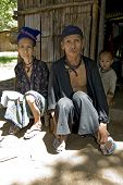 stock photo of hmong  - Old man and woman Hmong Laos sit in front of her accommodation