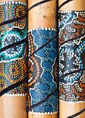 pic of didgeridoo  - Close up of three wooden african wooden musical instruments - JPG