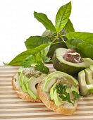 image of avocado tree  - Sandwich with avocado on a wooden strip board - JPG