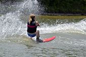 image of ski boat  - A young girl on a slalom course during a competition - JPG