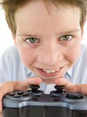 Young Boy Using Videogame Controller Smiling poster