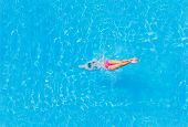 stock photo of sky diving  - Top view of a girl diving in the swimming pool - JPG