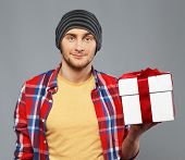 pic of beanie hat  - Stylish young man in shirt and beanie hat with gift box - JPG