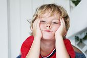 stock photo of boring  - Bored little boy - JPG