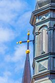 stock photo of cupola  - Church cross on a cupola  with blue heaven as background