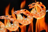 image of barbecue grill  - Grilled shrimps on the flaming grill - JPG
