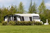 foto of caravan  - Caravan and camping tent on a camping site in Denmark.