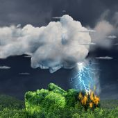 image of ignite  - Human communication concept with a lightning storm cloud and burning forest mountain shaped as a head as a business metaphor for igniting inspiration for innovation or a symbol of ideas that can damage or hurt - JPG