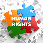 image of human rights  - Human Rights on Multicolor Puzzle on White Background - JPG