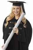 image of convocation  - Happy female graduate in academic dress holding diploma - JPG