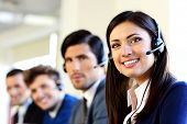 pic of telemarketing  - Smiling businesspeople in a call center office - JPG