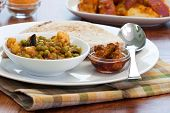 image of indian food  - Delicious dish of vegetable curry made with peas eggplant cauliflower tomatoes sauce  - JPG
