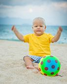 image of laughable  - Baby playing with toy ball - JPG