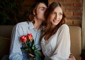 picture of sweethearts  - Portrait of amorous young man embracing his sweetheart and enjoying smell of her hair - JPG