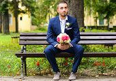 foto of fiance  - Groom waiting for bride and holding bouquet - JPG