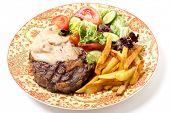 stock photo of rib eye steak  - Dinner plate of grilled rib - JPG