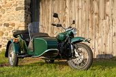 stock photo of sidecar  - Sidecar motorcycle in front of fieldstone and weathered wood background - JPG